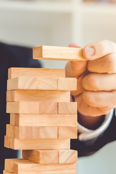 Businessman plan and strategy in business Domino Effect Problem